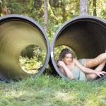 Beautiful Teen Girl in a Large Pipe — Stock Photo #4127374
