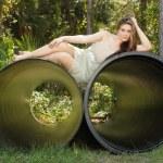 Beautiful Teen Girl Lying on a Large Pipe — Stock Photo #4127382