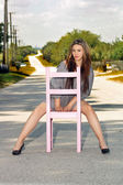 Teen Girl Sitting in a Chair in a Roadway (3) — Stock Photo