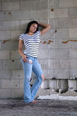 Sexy Brunette at a Block Wall (4) — Stock Photo