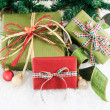 Three festive wrapped gifts — Stock Photo