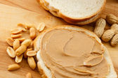 Peanut Butter on Bread with Peanuts — Stock Photo
