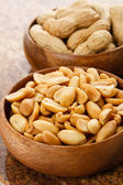 Peanuts in wood bowls — Stock Photo