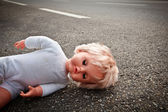 Doll leave on a highway lane — Stock Photo