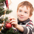 Royalty-Free Stock Photo: Boy decorates Christmas tree