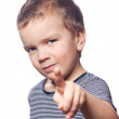 Small boy points his finger — Stock Photo #5137966