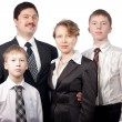 Portrait of family of four in suits — Stock Photo