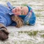 Small boy on football field, winter — Stock Photo #5138127