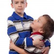 Younger brother looks at his big brother — Stock Photo #5138143