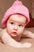 Portrait of small girl in a pink hat — Stock Photo
