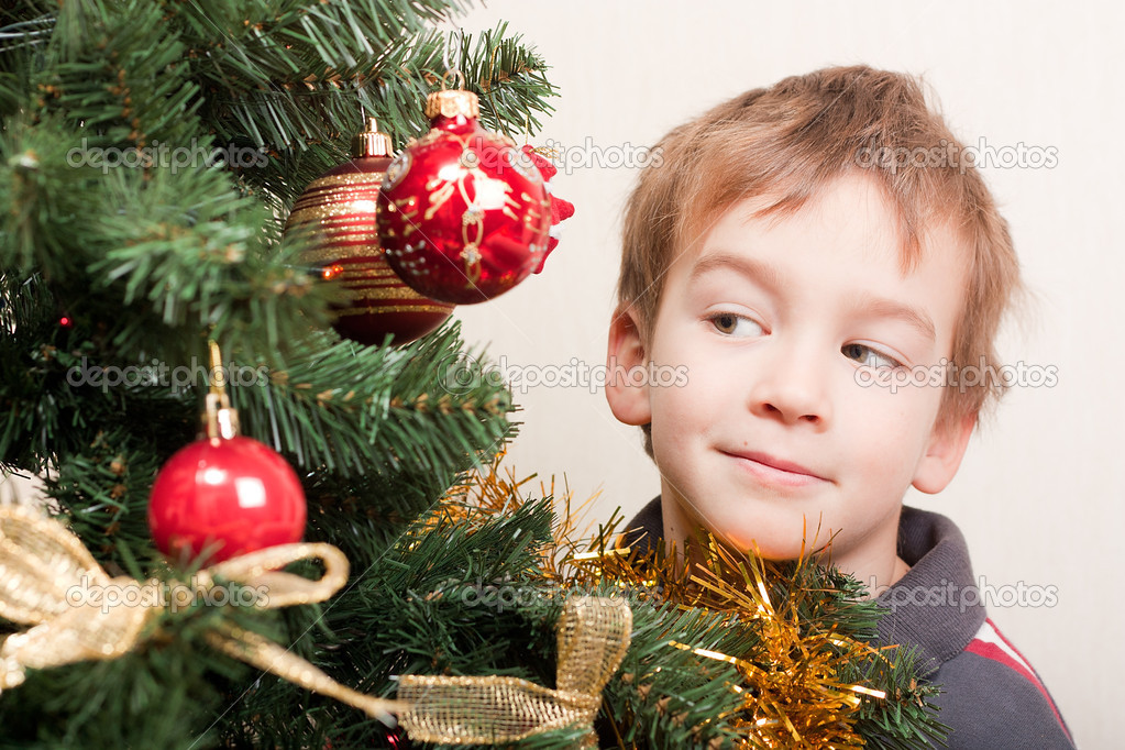 Boy looks out for christmas tree, indoor  Stock Photo #5137666