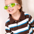Portrait of  young boy in green glasses — Stock Photo