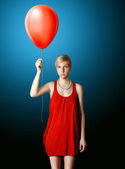 Blonde in red dress with the red balloon — Stock Photo
