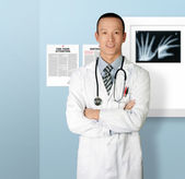 Doctor smiles at camera — Stock Photo