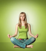 Woman meditation in lotus pose — Stock Photo