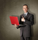 Businessman with red laptop — Stock Photo