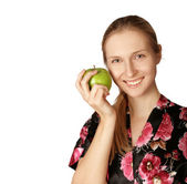 Happy woman with agreen apple — Stock Photo