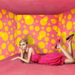 Стоковое фото: Surprised blonde in pink dress