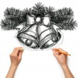 Sketch christmas bells with human hands — Stock Photo