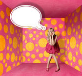Surprised blonde in pink dress with thought bubble — Stock Photo