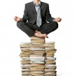 Businessman in lotus pose with many books near — Stock Photo #4674120