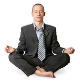 Businessman in lotus pose meditating — Foto Stock