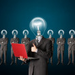 Businessman with lamp-head have got an idea — Foto Stock