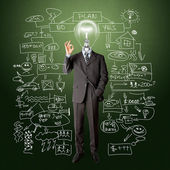Full length business male with lamp-head — Stock Photo