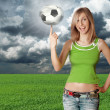 Happy girl with soccer ball on blue sky — Stock Photo #5046062