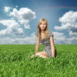 Blond in green grass — Stock Photo