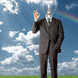 Stock Photo: Businessman with lamp-head holding blank card outdoors