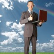Full length portrait of businessman with laptop outdoor — Stock Photo #5116324