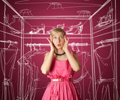 Surprised girl in pink — Stockfoto