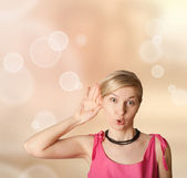 Woman overhearing something — Stock Photo
