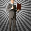 Full length portrait of businessman with laptop — Stock Photo #5173587