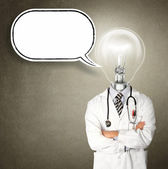 Doctor with lamp-head — Stock Photo