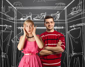 Female in pink and male in red — Stock Photo