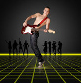 Punk man with the guitar and silhouette — Стоковое фото