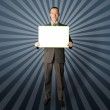 Happy businessman holding blank white card — Stock Photo #5324517