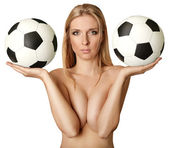 Beautiful naked woman with soccer balls — Stock Photo