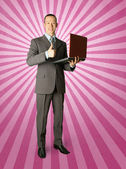 Full length portrait of businessman with laptop — Stockfoto
