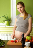 Pregnant woman on kitchen — Stock Photo