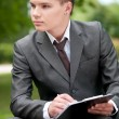 Business man working with papers at park. Student — Stock Photo #4954805