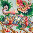 Stock Photo: Traditional Thai style church wall art with chines dragon