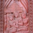 Stock Photo: Old wooden door were carved Thai Archaeology