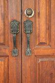 Vintage door handle on an wooden door — Stock Photo
