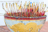 Joss-sticks on joss pot with yellow dragon — Stok fotoğraf