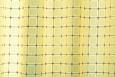 Square yellow curtain — 图库照片