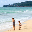 Mother and kid on beach — Stock Photo #4292263