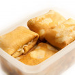 Foto Stock: Pancakes with filling in plastic box